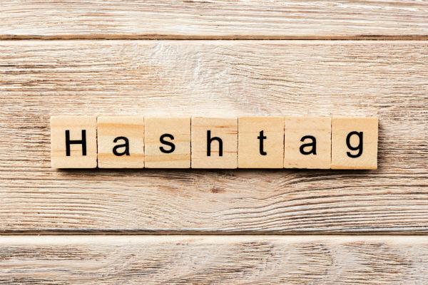 depositphotos_212556392-stock-photo-hashtag-word-written-wood-block
